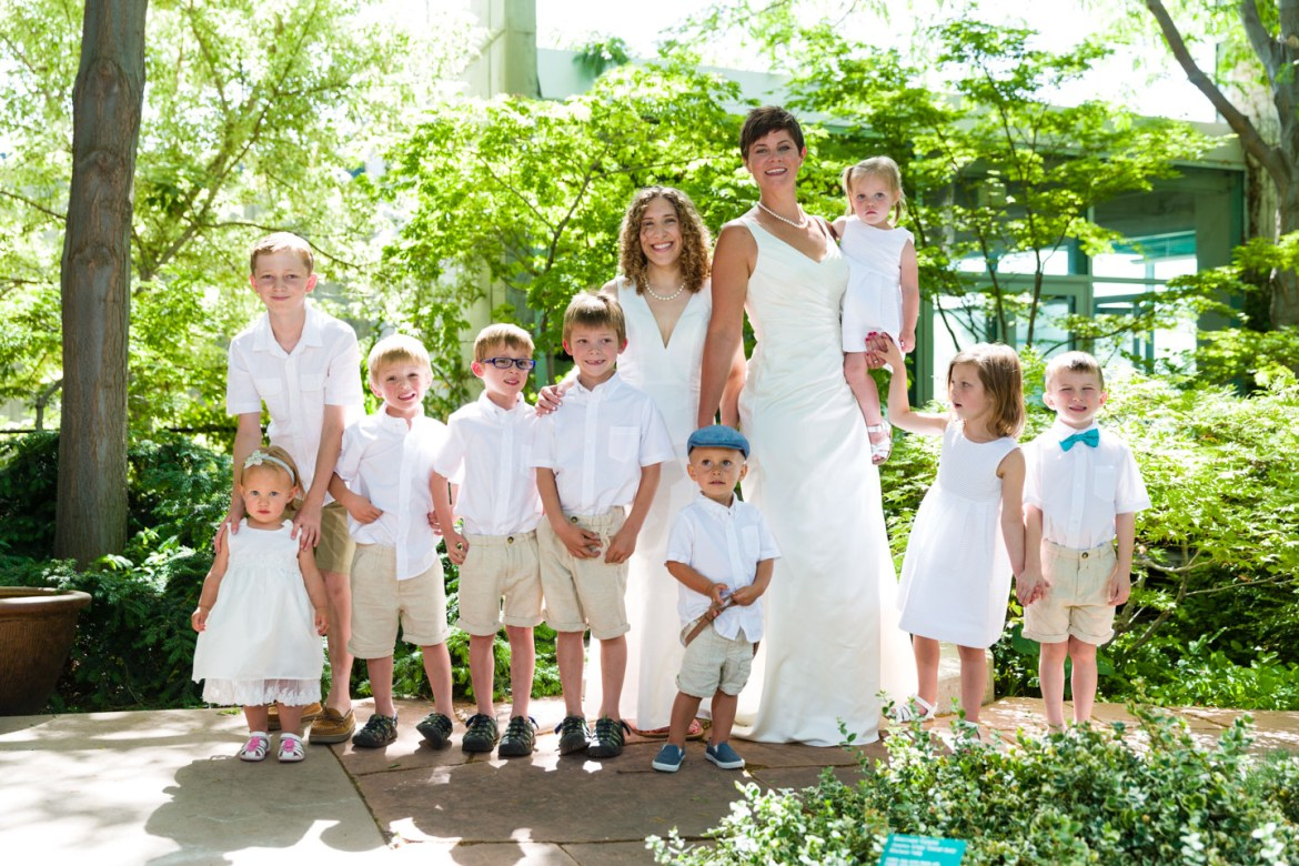 Dressed in white with nephews and nieces