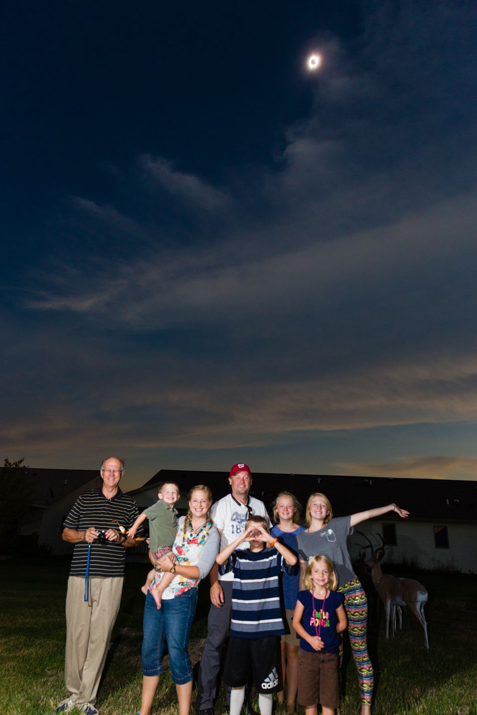 An impromptu family photo with the total solar eclipse