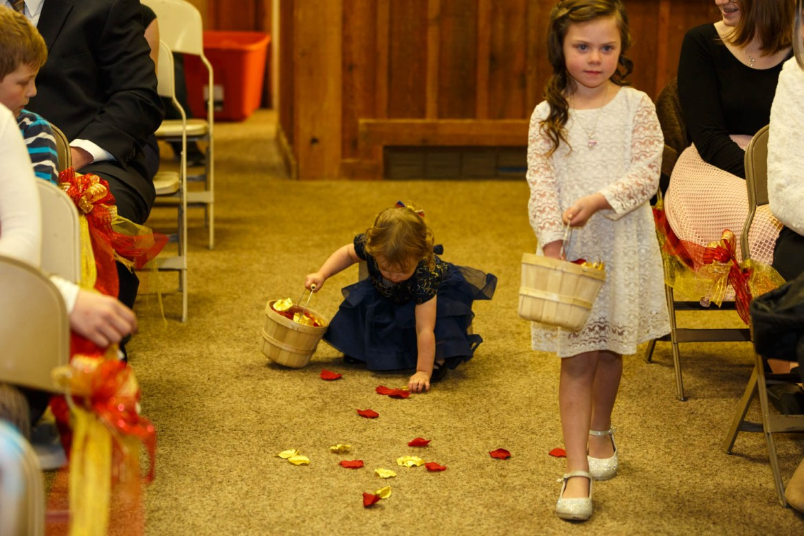 Flower girls dropping and picking up petals