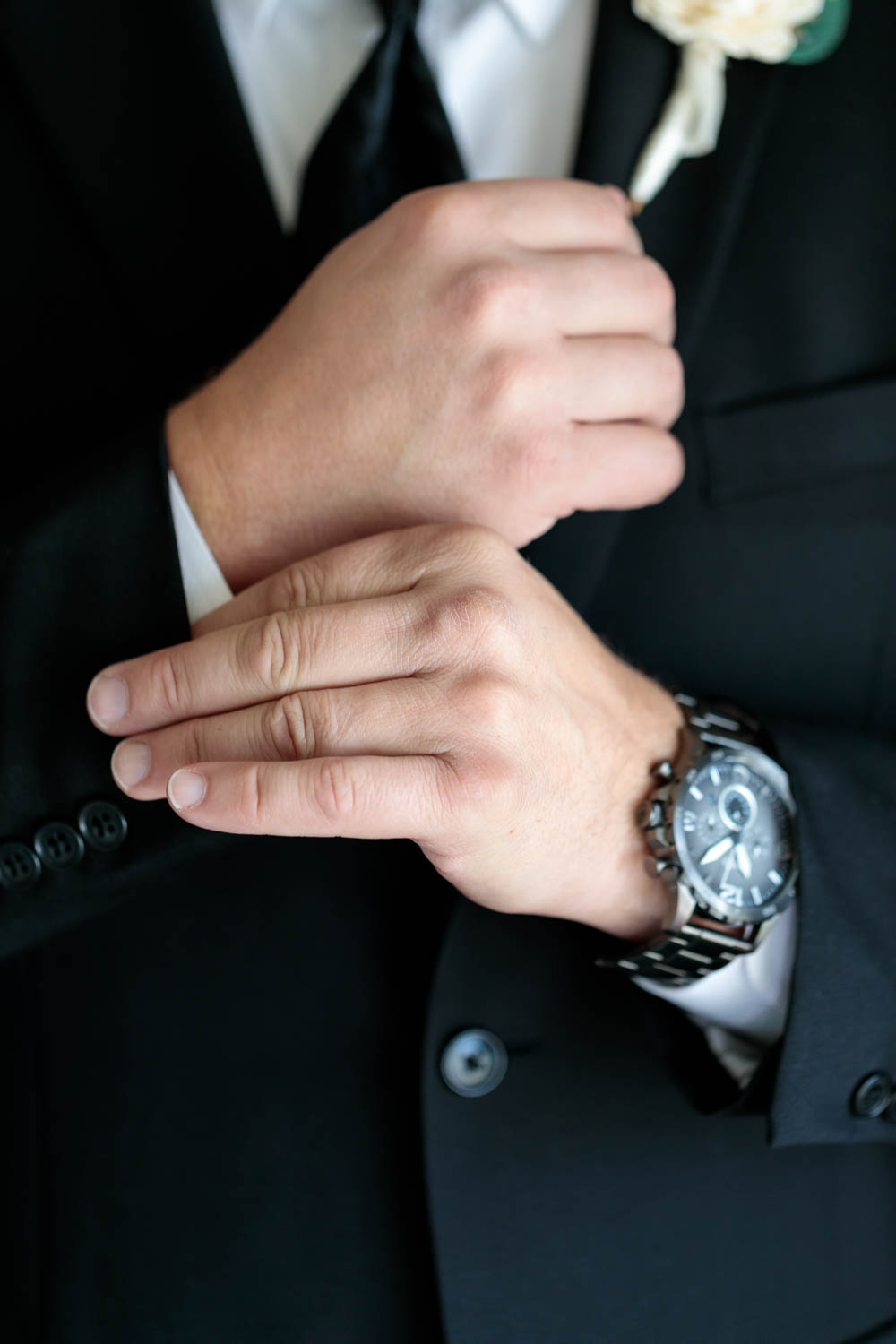 Groom adjusts the cuffs