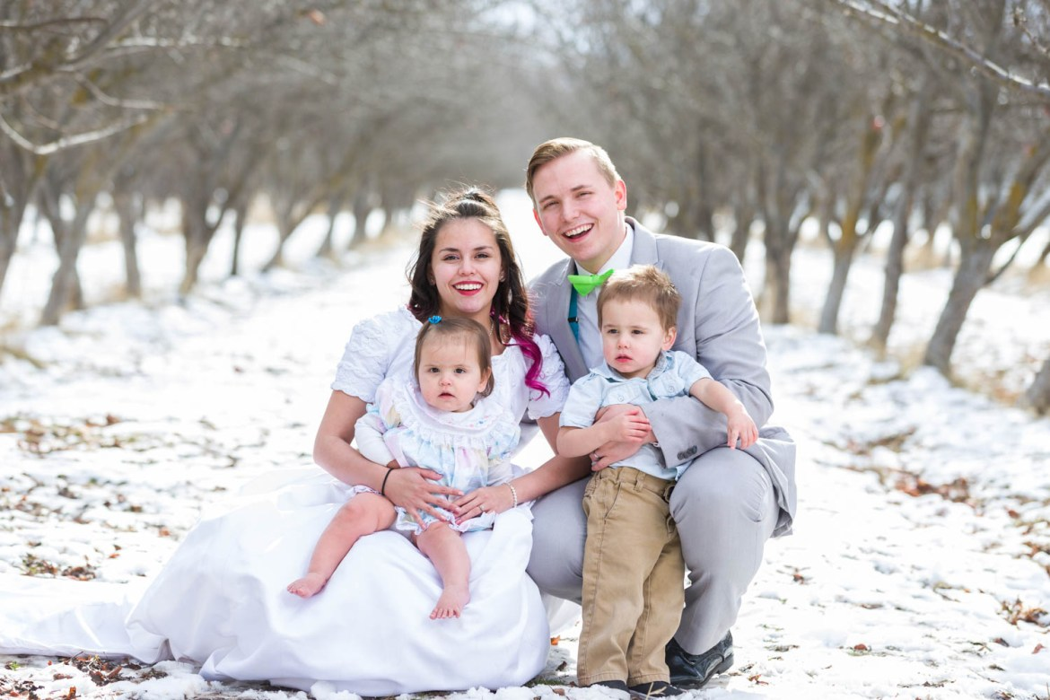 Family portrait in an apple orchard at winter