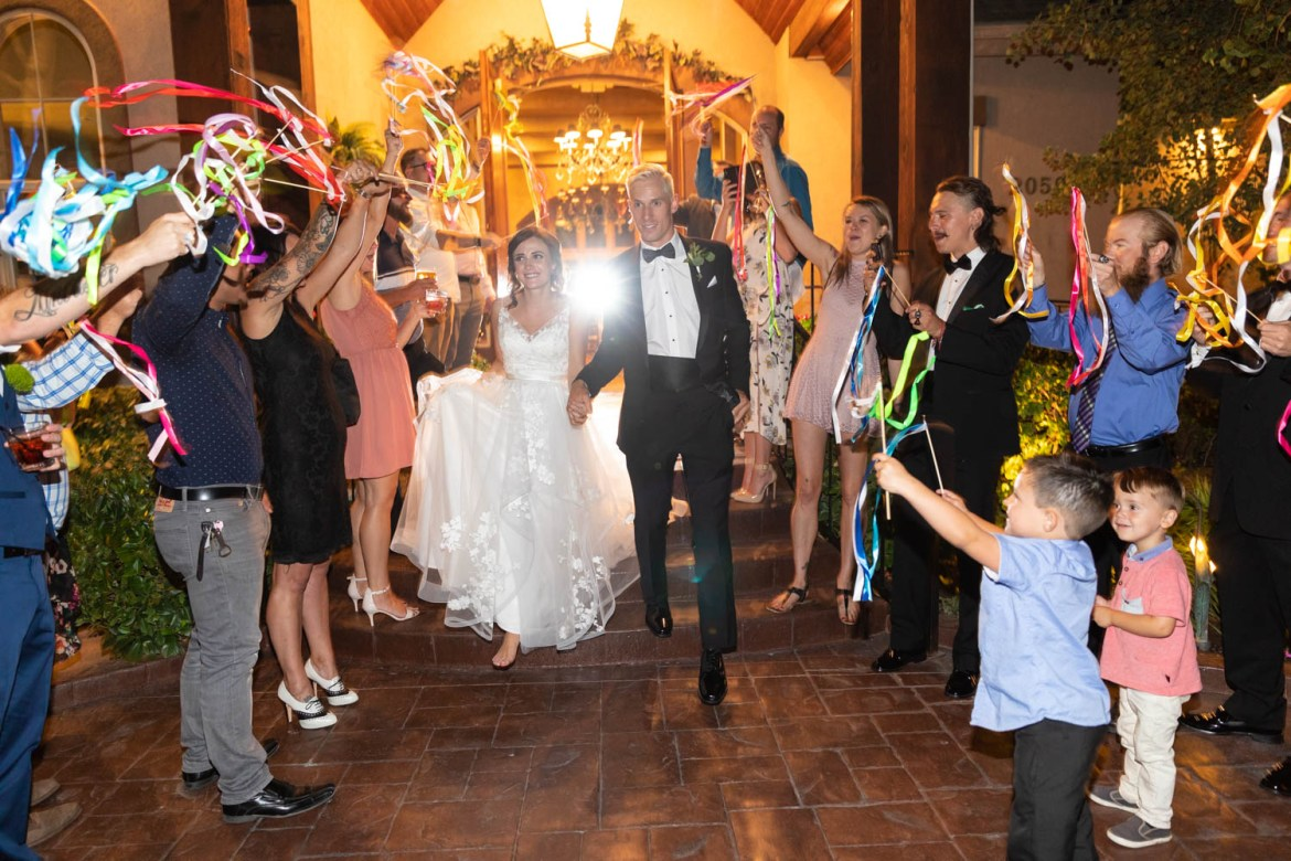 Bride and groom exit to a great celebration