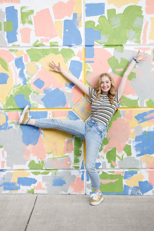 Graffiti backdrop with a fun pose