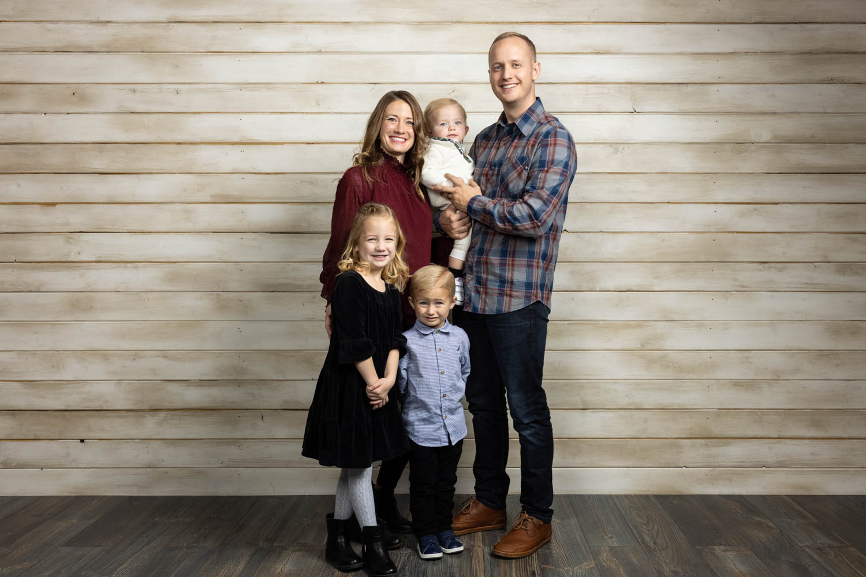 The whole family portrait on shiplap