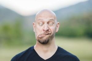 Adam creates a goofy face