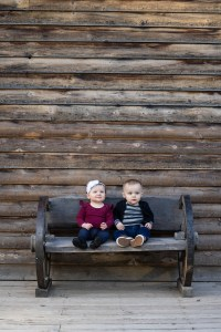 Brother and sister on a wooden bench