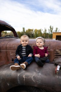 Brother and sister on an antique truck