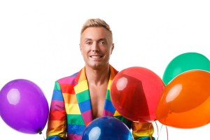Portrait with a Rainbow suit and balloons for Pride