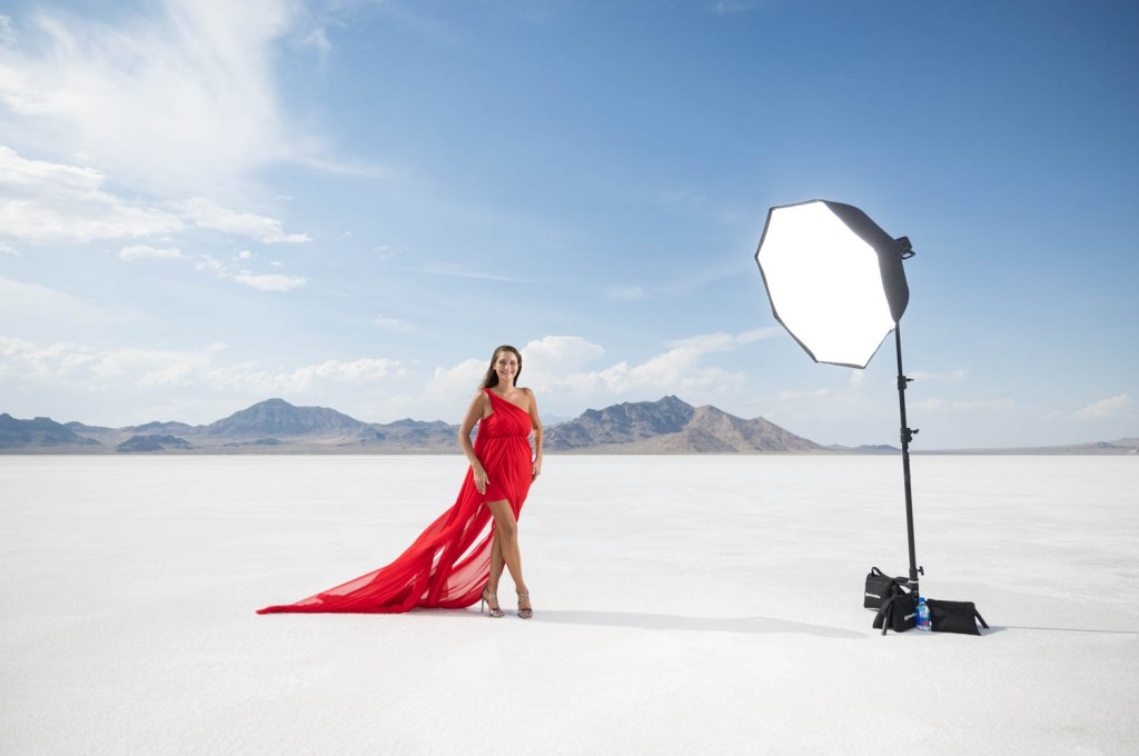 Behind the scenes of a Red dress model on the Bonneville Salt Flats
