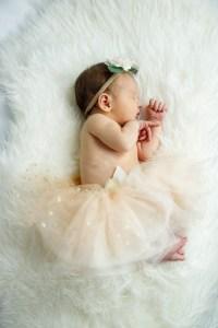 Baby Nora, dressed as a ballerina, dozing