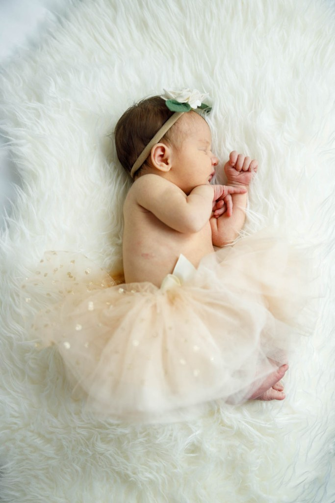 Baby Nora, dressed as a ballerina, dozing