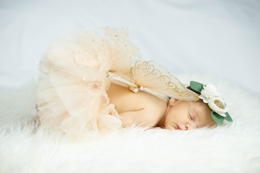 Baby Nora dressed as an angel ballerina