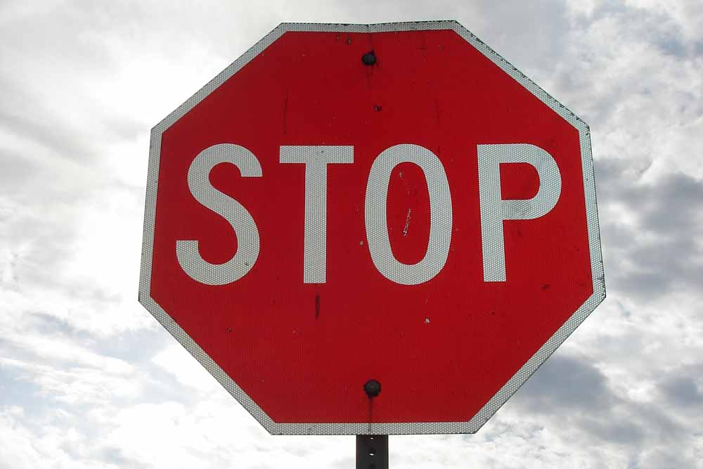 Stop using stop signs as default traffic control at intersections