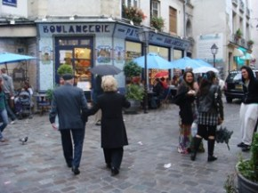 Older couple walking in Paris