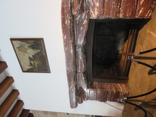 The fireplace with the mantle given to Hitler by Mussolini.