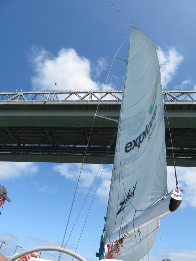 Sailing under the bridge.
