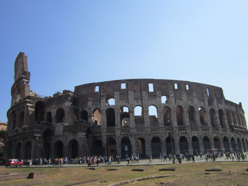 A view of the outside of the Colosseum - a major highlight of this Italy backpacking itinerary