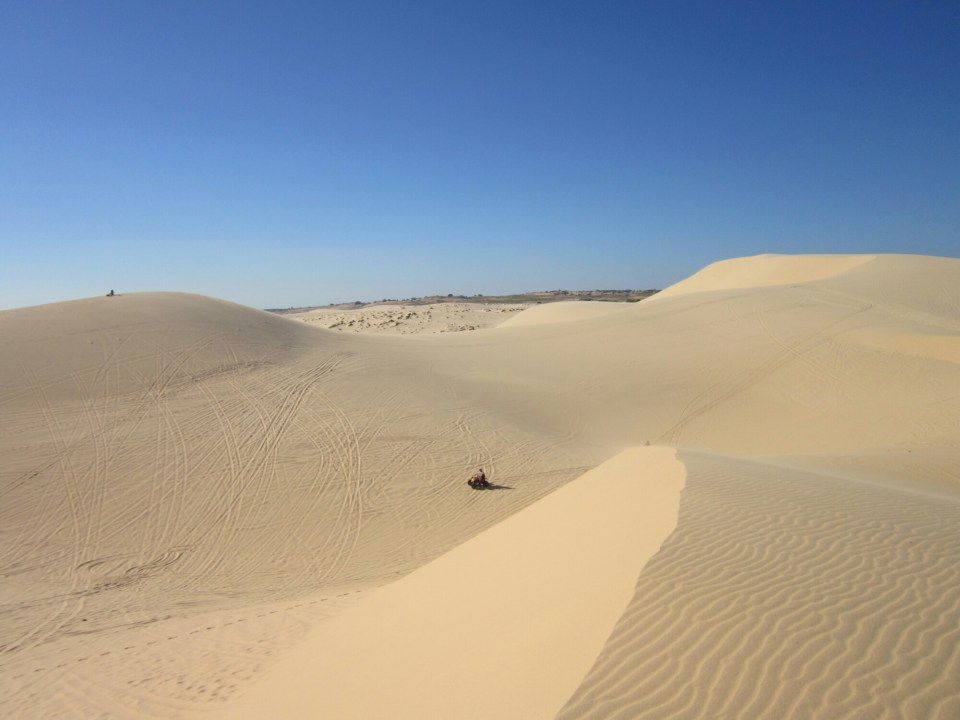 White Dunes with buggy in the distance. Near Mui Ne Vietnam