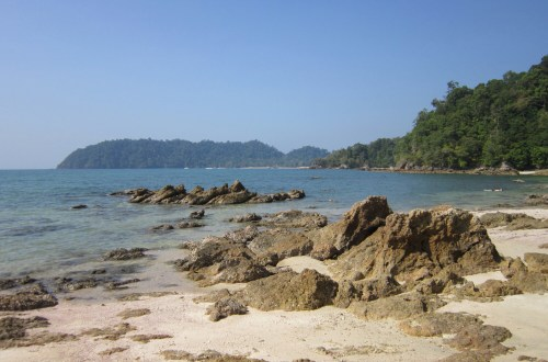Empty beach with sand and rocks, Koh Phayam, Thailand