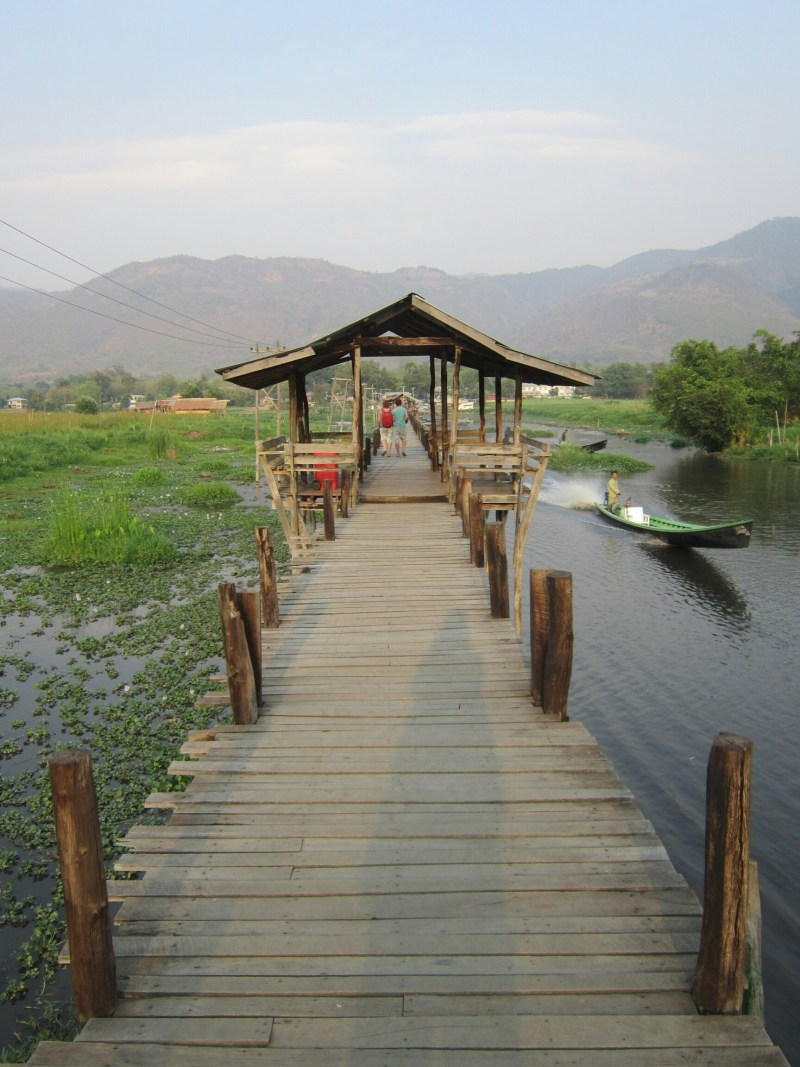 Standing on a Wooden bridge on Inle Lake, Myanmar