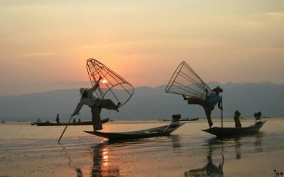 Fisherman pose at sunset on Inle Lake, Myanmar