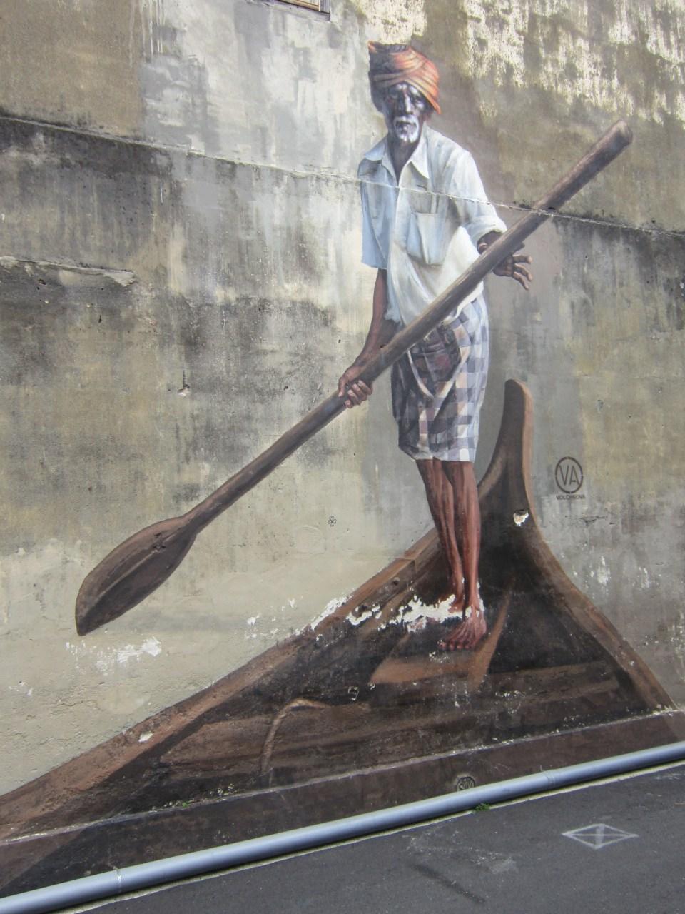 Penang Street Art Man paddling a boat