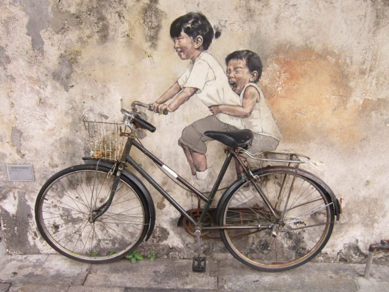 George Town Street Art - girl and bot on bicycle - Southeast Asia backpacking itinerary