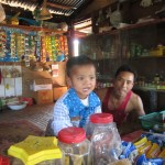 The People Of Myanmar - woman and child in a Shop to the south east of Kalaw
