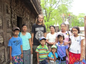 The People Of Myanmar - posing with a family visiting Shwenandaw Monastery in Mandalay