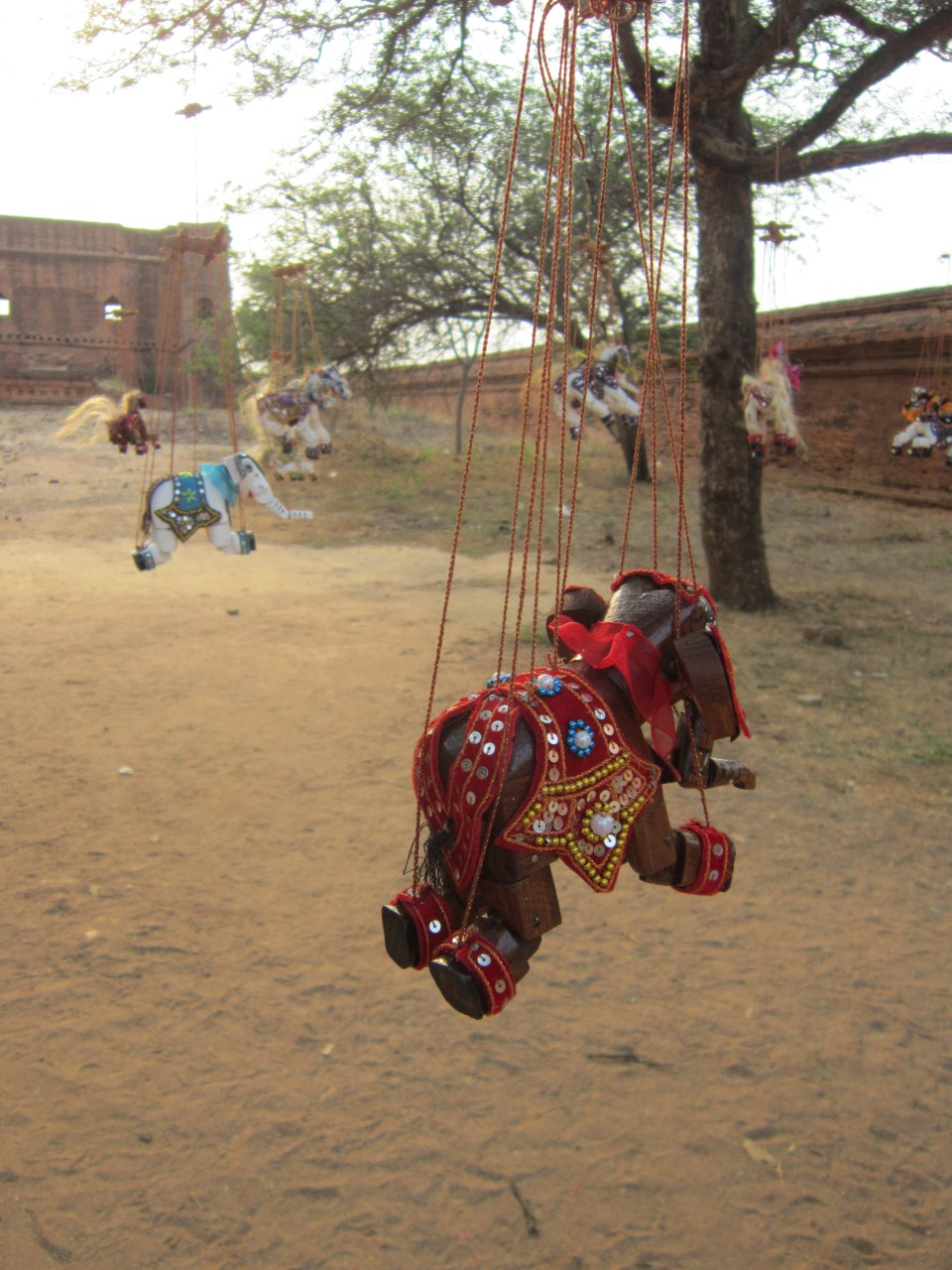 Decorations hanging from a tree in Bagan
