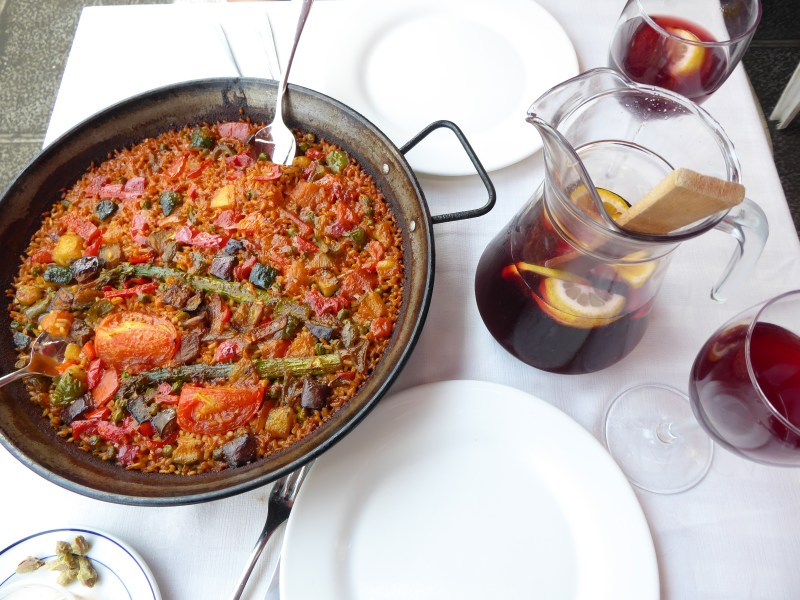 Things to do in Barcelona - Paella and Sangria on a dinner table