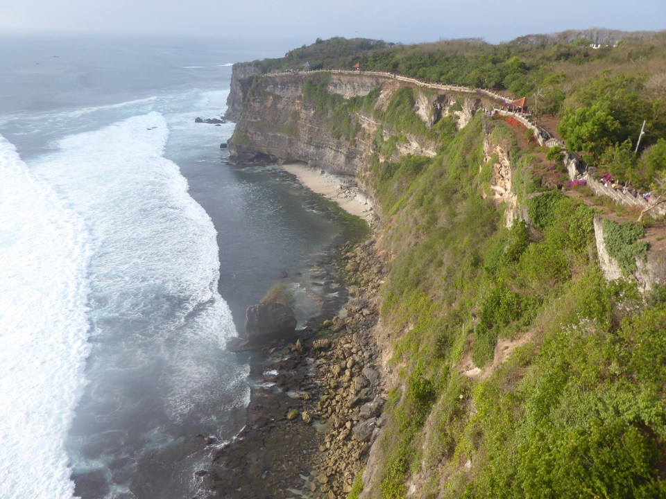 The Uluwatu temple coastline - looking down at cliff-side and sea (backpacking Bali)
