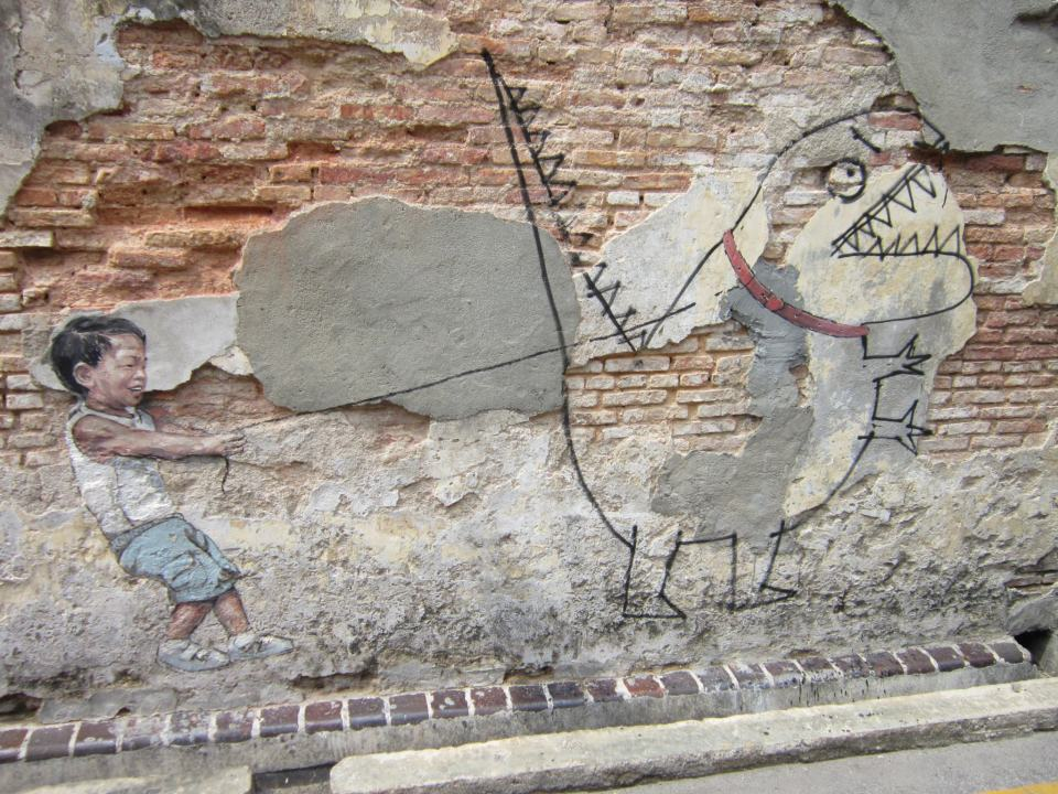 Little boy with a pet dinosaur by Ernest Zacharevic
