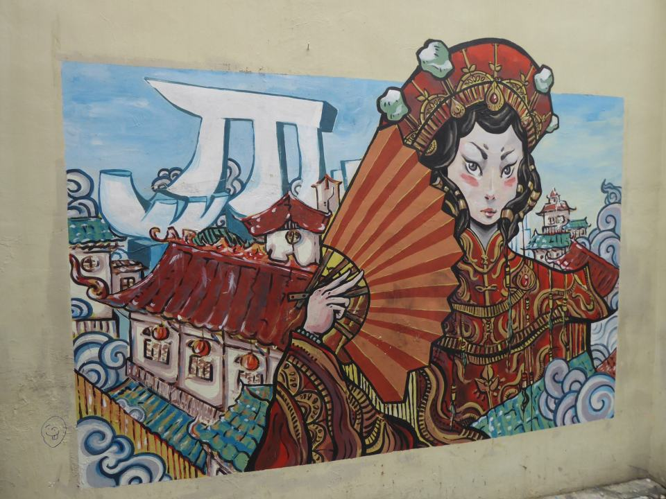 Street Art in China Town - woman and fan (with buildings in background) and Chinese writing - Singapore Travel Guide