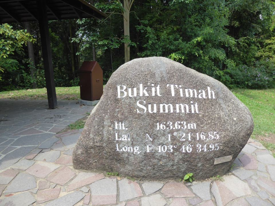 Stone marking the top of Bukit Timah in Singapore with height written in white writing