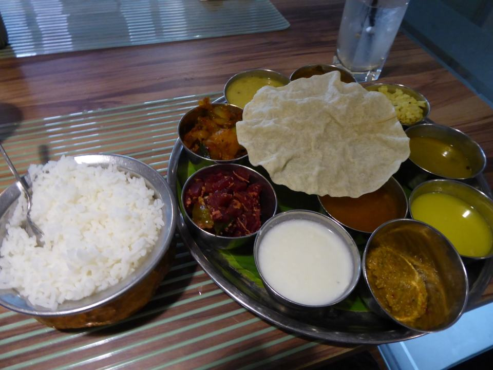 A Thali meal in Little India - featuring rice, several currry and dahl posts, - Kuala Lumpur Travel Guide