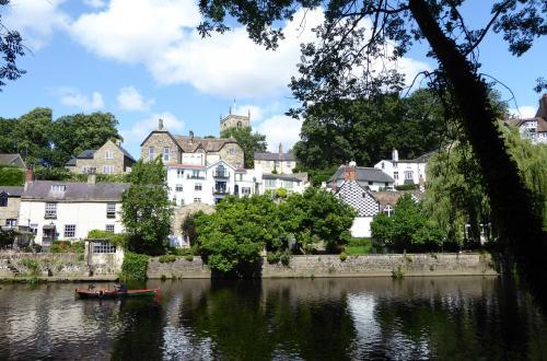 View across the river of buildings in Knaresborough.