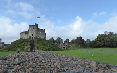 Cardiff Castle - featured image of castle in background with the Roman gate to the side
