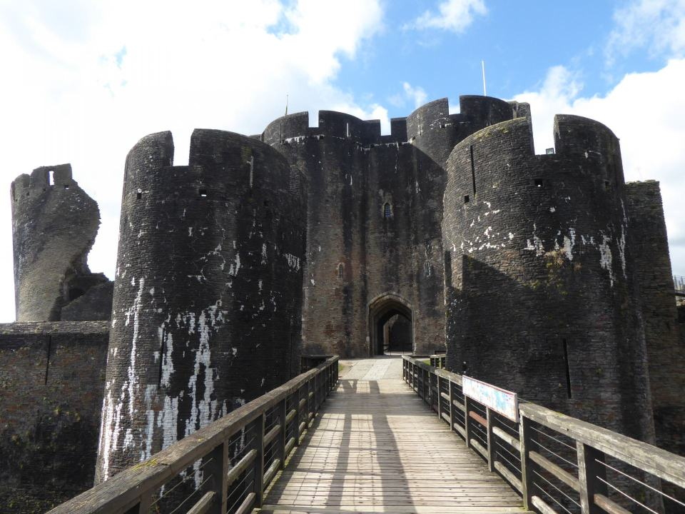 Walking across the Bridge to enter the main section of Caerphilly castle