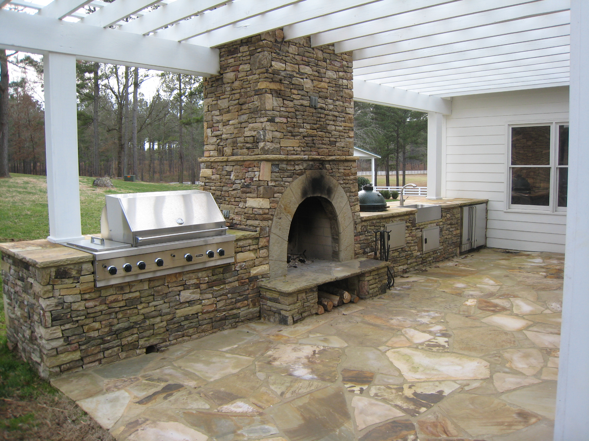 Outdoor Kitchens & Stone BBQ Design | Davel Construction on Outdoor Kitchen And Fireplace Ideas id=23332
