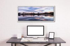 The first rays of sun catching the mountains tops around Derwent Water at dawn - White Maple floater frame with acrylic glazing on Wall