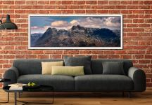 The snowy summits of the Langdale Pike and the dark rock face of Pavey Ark - White Maple floater frame with acrylic glazing on Wall