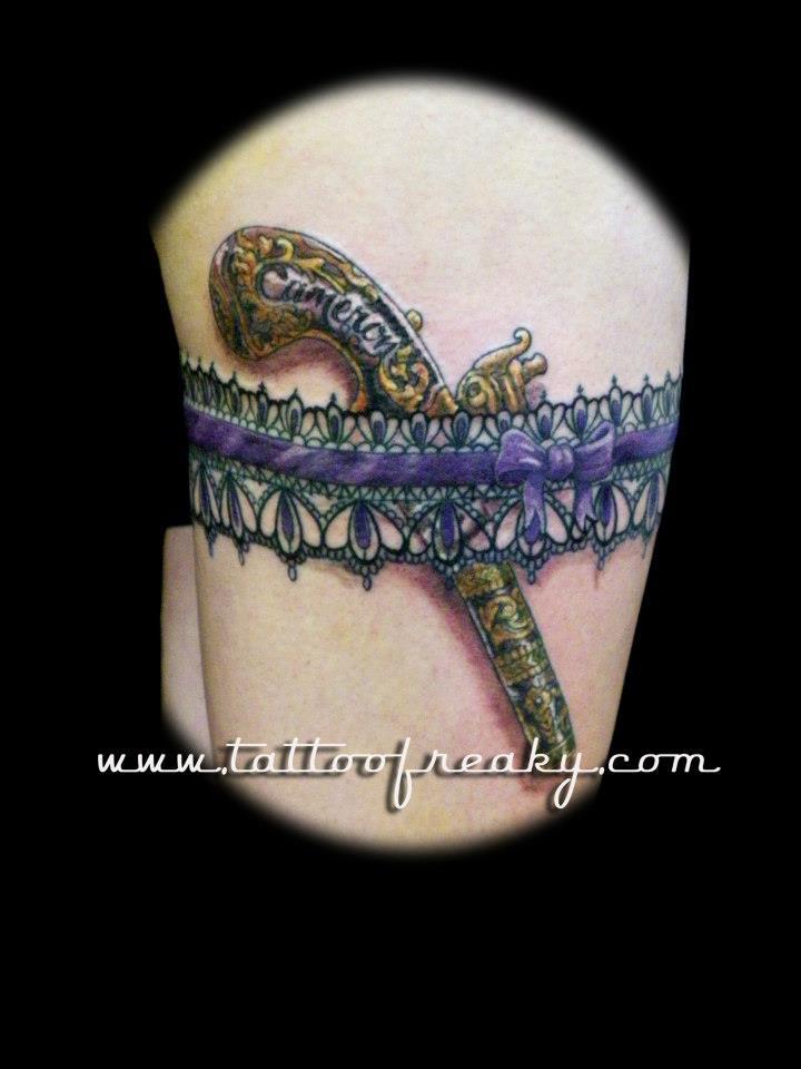Garter and gun Tattoo