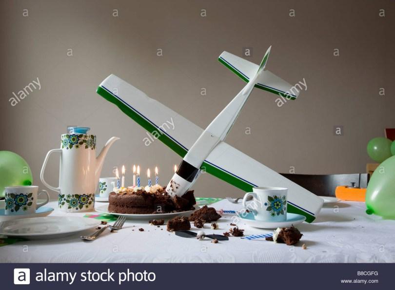 Airplane Birthday Cake Model Airplane Flown Into Birthday Cake Stock Photo 22404020 Alamy