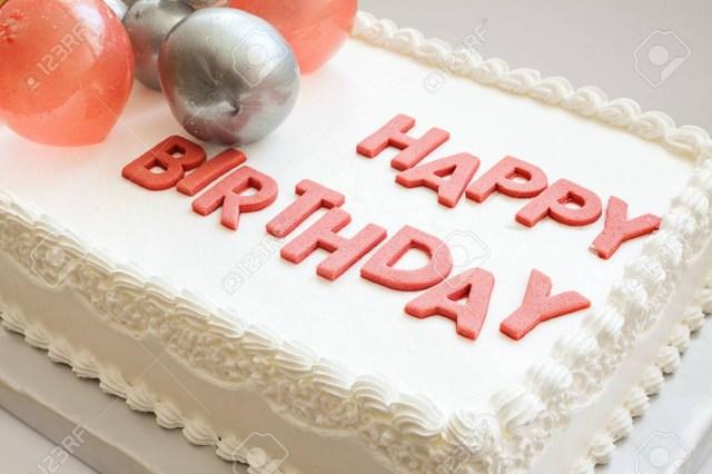 Happy Birthday Cake Pic Details Of A Happy Birthday Cake On White Background Stock Photo