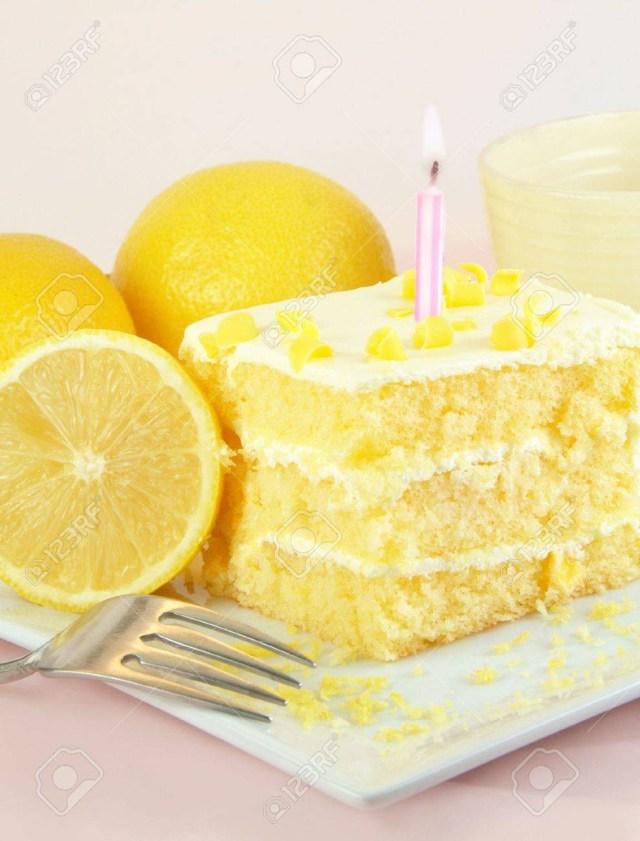 Lemon Birthday Cake Lemon Birthday Cake With One Lit Candle Lemons And Fork On