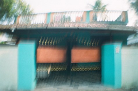 Scenes of Life in Tripunitura & Kochi: houses were painted sherbet colour shades of orange, blue, green, fuchsia and so on