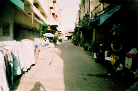 Scenes of Life in Phitsanulok: laneway with items