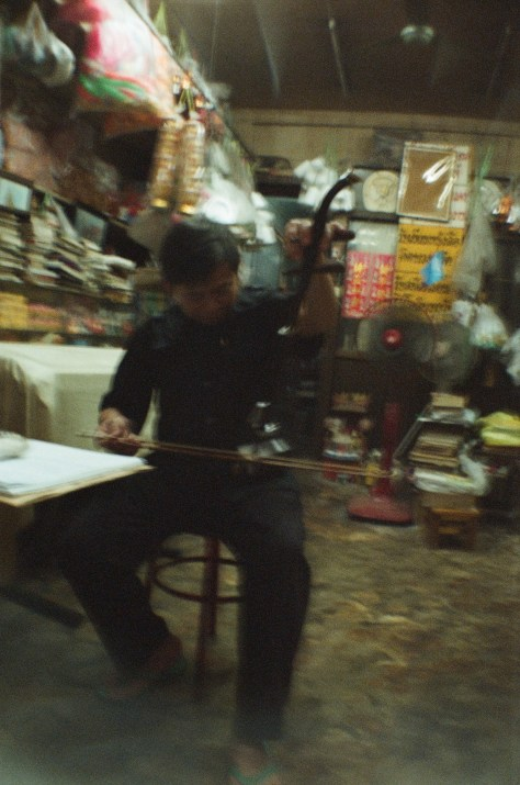 Scenes of Life in Phitsanulok: repairing traditional musical instrument