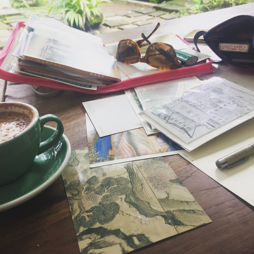 Postcard Still-life: Ubud with inky stamps and cappuccino